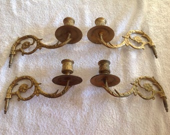 Four Brass Candle Holders.