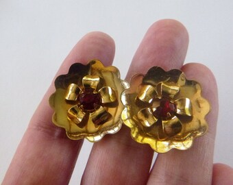 Large gold tone flower earrings with red rhinestone centers non-pierced screw backs