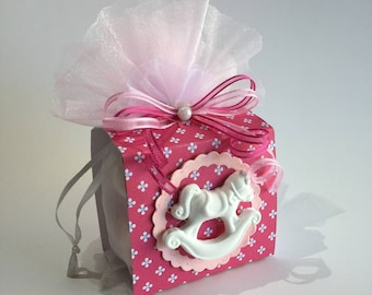 Fuchsia and pink favor bag with rocking horse baptism baby