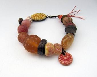 The Light Is Without Calculation - rustic peach pink amber orange bracelet; unique mixed media grungy primitive assemblage bracelet