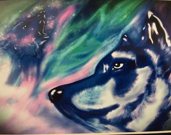 Wolf faces  and howling wolf in aurora borealis