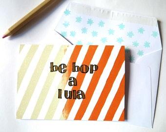 Handprinted greeting card//Be Bop A Lula//beige+orange stripes