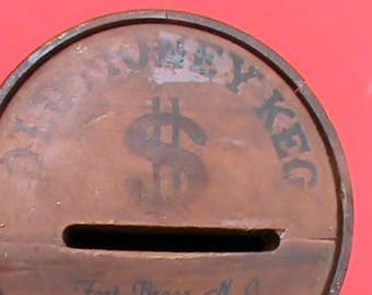 Neat old vintage wood coin bank. Old Money Keg Fort Bragg NC