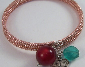 Pink Charm.. Pink and turquoise czech glass, seed bead memory bangle bracelet