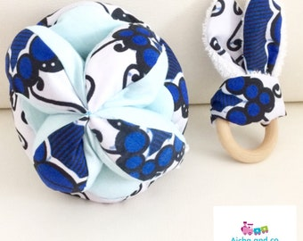 Duo gripping wax montessori ball blue white and his Bunny teething ring rattle