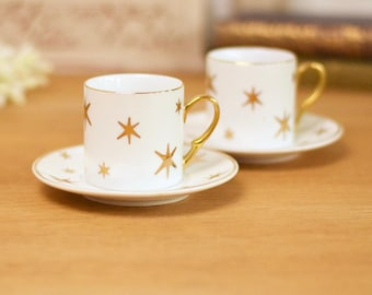 Pair of coffee cups and saucers, gold star pattern on white,vintage bone china.
