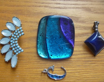 four pendants in shades of blue