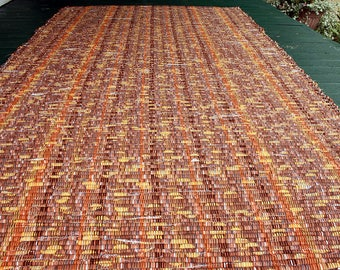 Handwoven cotton rug in copper, brown, rust and gold