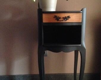 Matte black baroque bedside table
