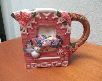 Decorative ceramic pitcher to Make your own floral centerpiece (flowers not included)