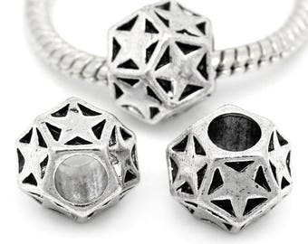 Large hole faceted beads and silver metal stars.
