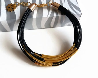 Black multi strand bracelet gold tube Black bracelet women Tube bangle bracelet Stacking bracelets for women Tube bead bracelet Black Cuff
