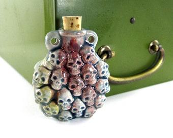 Peruvian Ceramic Raku Stacked Skull Bottle