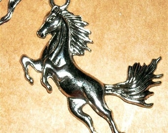 Horse Charm   jumping horse equestrian silver measures  50mm or 2 inches long quantity one  Drw500drw425