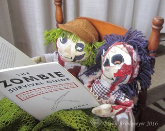"Custom-made ""Maggoty Ann and Andy"" zombie dolls"