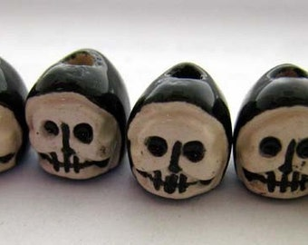 4 Tiny Hooded Skull Beads