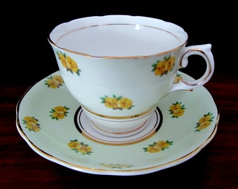 Crown Essex Green And White  Bone China Teacup And Saucer Set. Made in England
