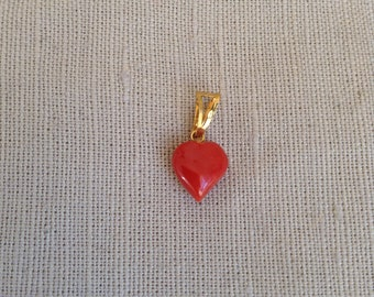 "1980's coral ""heart"" pendant."