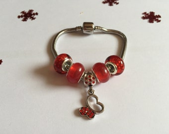 Red charm's bracelet with charms Butterfly ref 789