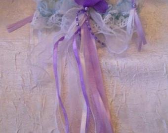 Purple color bridal garter / white