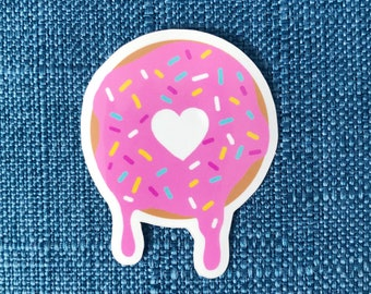 I love Donuts glossy vinyl sticker - pink donut with sprinkles with a heart shaped hole dripping icing. Doughnut sweet cute melting donut