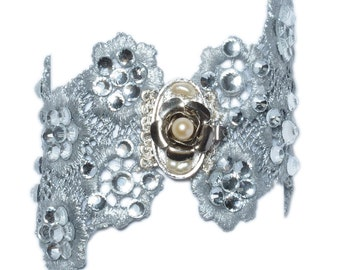 Silver and flashy swarovsky bracelet. It could go with a head piece with similar decor.