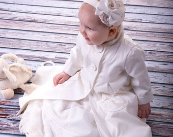 The children's coat baptism made of soft cotton batiste. The base fabric and cotton lace in ecru.