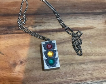 Vintage traffic light necklace. Battery operated.