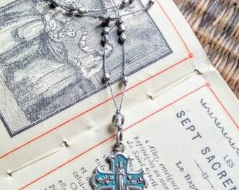 Vintage turqouise cross pendant necklace .