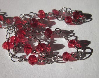 0.20 cm silver-plated chain topped with red glass beads