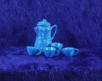 Dollhouse Miniature accessory in twelfth scale or 1:12 scale; Blue spatter coffee pot with 4 cups.  Metal.  Item #D461.