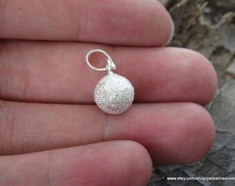 Shiny silver pendant spherical shape
