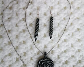 Beautiful set of polymer clay pendant and torpedo earrings in silver and black