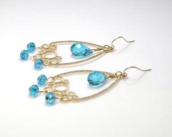 Blue and gold chandelier earrings, long earrings with bubble design 14k gold plated and Swarovski color blue.