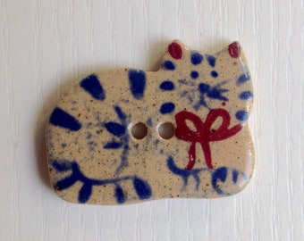 Hand-Painted Porcelain Button, Tan Porcelain, Resting Cat, Blue & Red Paint, Two Hole
