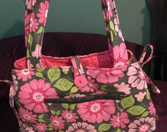 Expandable pink flowered tote bag with lots of pockets