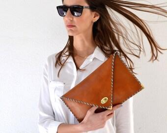Light camel leather clutch
