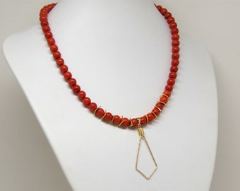 Necklace coral with a gold filled pendant
