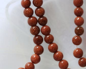set of 5 gold sand stone beads