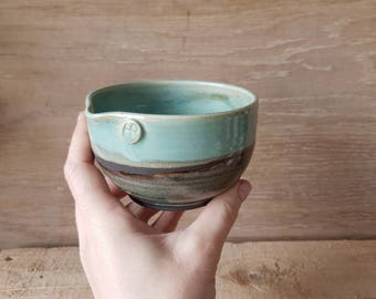 Small turquoise and black bowl with pouring lip. Handmade stoneware ceramic by Holly bell