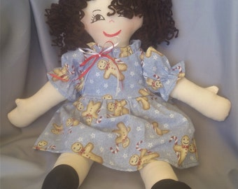 15 inch cloth (rag) doll, with hair and eye color of your choice, comes dressed in a cheerful holiday dress and white panties