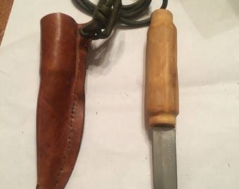 Grapewood knife and leather sheath with strap.