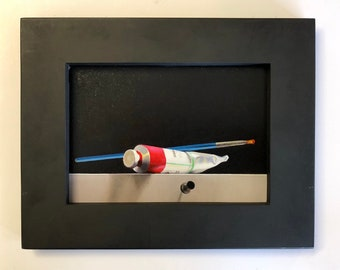 Framed Realistic oil painting of paint tube and brush by Brian Burt