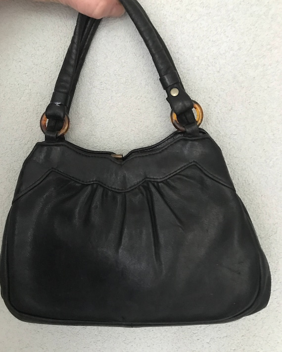 Vintage black leather fifties handbag, tophandle bag with lucite detail