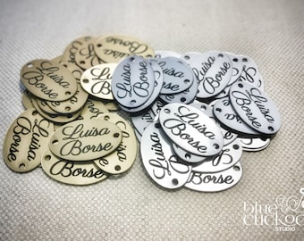30 plastic tags (look like metal), laser cut and engraved