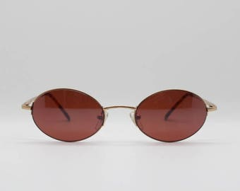 90's sunglasses. Vintage oval shades. Original NOS, gold metal frame with brown lenses. NWT. Y2K. 00's. 2000's. Steampunk. John Lennon.