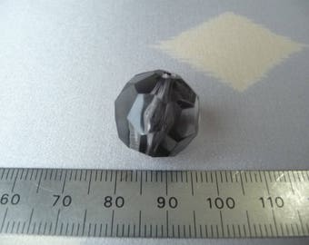 A black plastic faceted bead