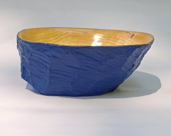 Bowl carved from a beaver tree stump, painted blue