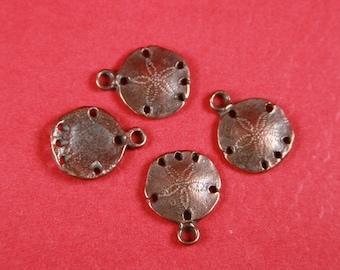 2/9 MADE in GREECE 4 Mykonos casting sand dollar charms , copper sand dollar, tiny copper sand dollar charms (X4285AC)Qty4