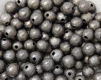 50 beads, Gunmetal Gray Stardust 10mm Spacer beads